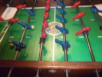 You are bidding on a Foosball table that is over 25