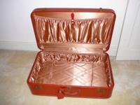 A classic, rectangular hard case in saddle tan leather,