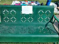 Vintage metal porch glider. Dark green paint. $100.