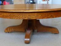 This is a vintage round oak dinning table that was made