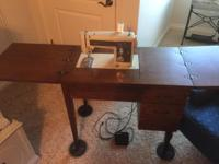 Vintage Sears/ Kenmore sewing machine in its original