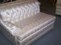 We are selling our mom's creme satin, with tufted back,