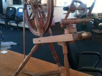 This is an incredible vintage spinning wheel.