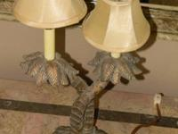 This is a vintage palm tree table lamp with dual stem