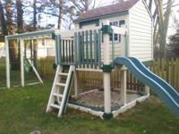 Wooden Swing set covered in Vinyl. 3 swings monkey bars