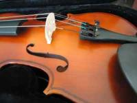 like new 3/4 violin w/case, bow, rosin, extra set of