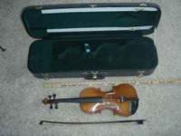 "Violin, hard case, and bow. 3/4 size. 22"" long. Made by"