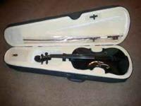 Black fiddle that comes with case, bow, and other