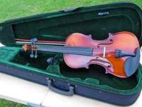 Fulll-size violin outfit. Case is equipped with a