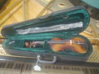 New, closeout.  1/8 size violin w case and bow.  Fine