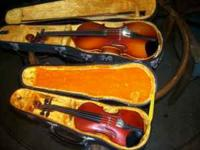 The large violin was made by Kiso Suzuki Violin Company