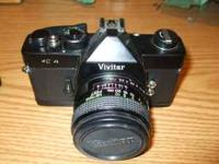 Vivitar 35mm camera with lenses. Screw on type lenses