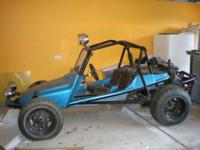 This is an original 1966 Meyers Tow'd Dune Buggy.