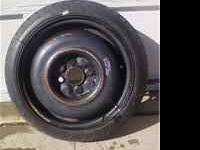 Two temporary spare tires on wheels for sale. 115/70/14