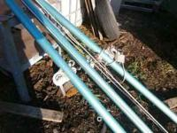 VOLLEY BALL ALUMINUM NET POLES. Two with cranks on the