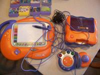 cost lowered. VTech Smile Console and 16 video games.