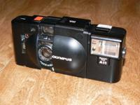 Available is this Super clean Olympus XA 35mm camera