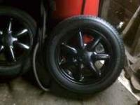 set of four gti rims painted gloss black. no tires.