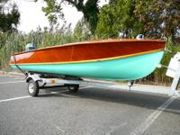A real classic lakes or bay boat, outboard runabout,