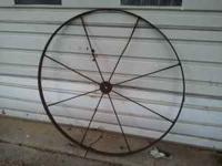 Antique wagon wheels solid not week a pair for $125 obo
