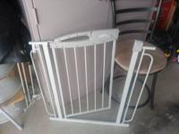 walk through gate with extender. Can be secured with
