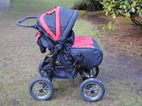 Double running stroller. Has air tires. Seat covers go