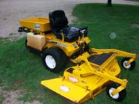 "Walker zero turn mower with 25 horsepower, 52"" deck,"