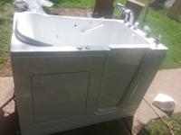 walkin handicap tub for sale. exceptional condition.