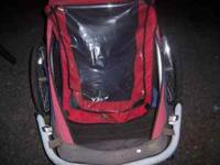 Holds 2 Children. Gently used. 3 wheels. call