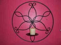 "Metal wall candle holder 13"" diameter asking $5.00."