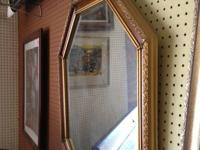 Very nice medium sized wall mirror. The border of this