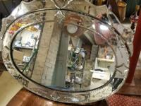 Unique wall mirror, oval crown like appearance at top,