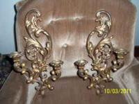 Pair of gold colored wall sconces.  Location: