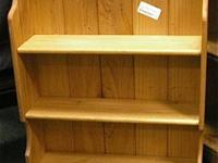 This wall surface storage space or curio shelf has 2