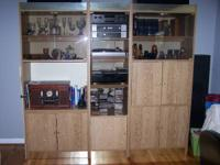 This wall unit is Oak laminate with smoked glass doors.