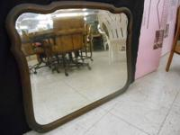 Wood Framed Mirror has a couple nicks, by Raymond and