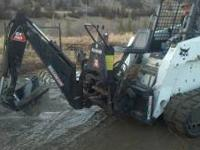 For skidsteer Gx 700 model. 7' Dig depth, 2 buckets