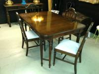 Unique vintage dining table with double-leg
