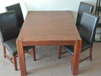 Walnut table with 8 matching, original chairs. Minor