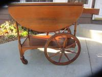 Beautiful antique solid walnut drop leaf tea cart with