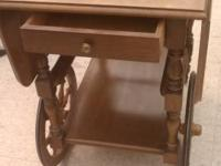 This is a stunning walnut tea cart with drop leafs on