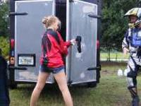 Gray trailer with Morava Auto decal on the side and