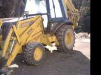 WANT TO TRADE A 1992 CASE 580K BACKHOE 4X4 ,CAB