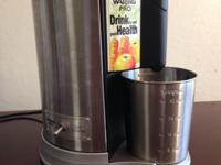 Waring Pro juicer machine in like new condition. This