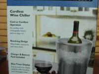 This WARING WINE CHILLER IS NEW IN BOX. It was a gift;