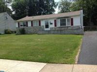 Nicely maintained single ranch offers hardwood floors,