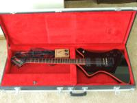 Comes with a Washburn case and a Peavey Backstage Plus