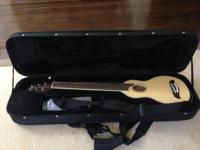 The is the Washburn Rover RO10 acoustic travel guitar,