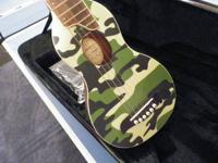 Cool little guitar that is easy to pack and play (not a