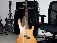 Washburn XB100 Bantam Series 4 string bass guitar. 34